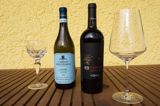Two interesting Italian varietals, one white and one red. On the left, a wine made from the Arneis grape, and a bottle of Negroamaro on the right (photo © hidden europe).