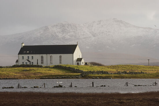 St Michael's Church at Ardkenneth occupies an uncompromisingly bleak spot in the north-west corner of South Uist. The church and the parish priest's home are combined in a single graceful building (photo © hidden europe).