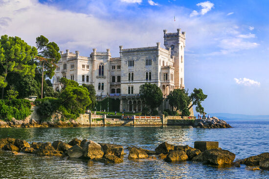 Search for the spirit of the late Jan Morris in the waters around Miramar Castle near Trieste (photo © Freesurf69 / dreamstime.com).