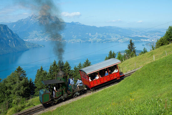 Climbing up above Vitznau towards the Rigi. Note the unusual vertical boiler on the steam engine. Most trains these days are operated by modern electric railcars (photo © David Gubler licensed under CC BY-SA 3.0).