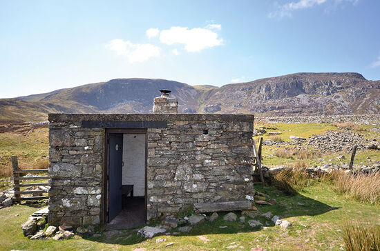 The Mountain Bothies Association bothy at Arenig Fawr, where a good view counts for much more than sybaritic comfort, is one of 26 bothies featured in a new book by Phoebe Smith on Britain's mountain bothies. The book is published by Cicerone (photo © Phoebe Smith and Neil S Price).