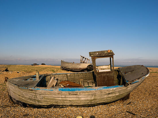 Abandoned boats are a reminder of the once much larger fishing industry on Dungeness Foreland. A handful of families are still involved in fishing (photo © hidden europe).