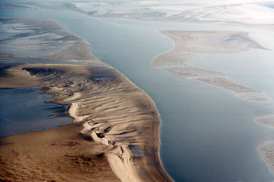 Aerial photo of part of the Wadden Sea National Park in Schleswig-Holstein, Germany (photo © 3quarks / dreamstime.com).