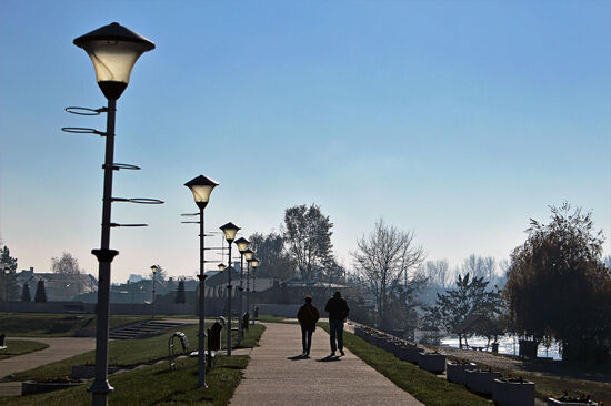 Strolling along the riverside promenade of Novi Becej, a small town on the shores of the River Tisa in Serbia's Vojvodina region (photo © Laurence Mitchell).