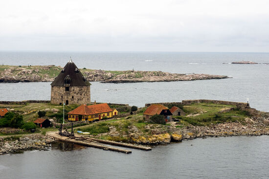 Looking from Christiansø over the harbour mouth to the island of Frederiksø with its Napoleonic-era defensive tower (photo © hidden europe).