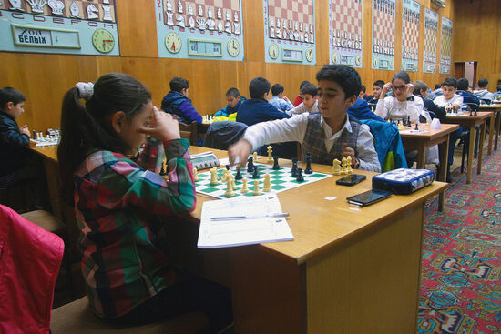 Children improving their chess skills and taking notes at Tigran Petrosian Chess House in Yerevan (photo © Emma Levine).