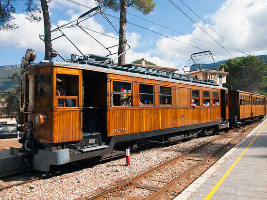 A Palma-bound Ferrocarril de Sóller train at Bunyola on the island of Mallorca (photo © hidden europe).