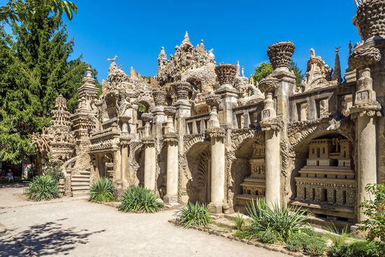 An early experiment in surrealism, this extraordinary 'palace' graces a garden in the French village of Hauterives. It was built by the local postman (photo © Milosk50 / dreamstime.com).